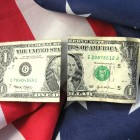 USA FATCA tax law - dollars and USA flag