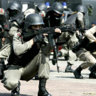 Indonesian anti-terror police unit show their skills during a security drill